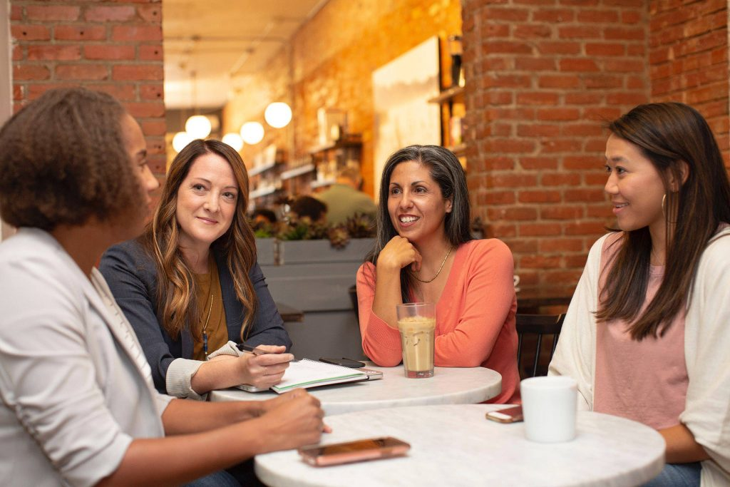 women engaging at a cafe